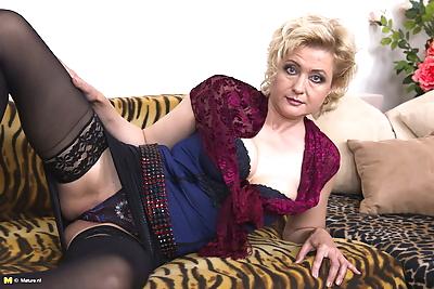 Older blonde cougar gets her..