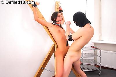 Brunette gets tortured and..
